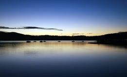 Por do sol sobre a lagoa Foto de Stock