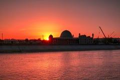 Por do sol sobre a mesquita do meshiti de Muhammad Imam Iyshan, Nukus, Karakalpakstan, Usbequistão imagem de stock