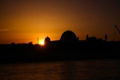 Por do sol sobre a mesquita do meshiti de Muhammad Imam Iyshan, Nukus, Karakalpakstan, Usbequistão foto de stock royalty free