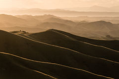 Por do sol sobre montes e vales Foto de Stock Royalty Free