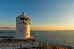 Por do sol sobre o farol em Kavala, Grécia fotografia de stock royalty free