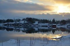 Por do sol sobre o fjord Imagem de Stock