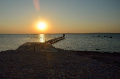Por do sol sobre o golfo Imagens de Stock