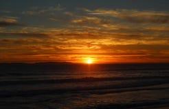 Por do sol sobre o Huntington Beach Fotos de Stock Royalty Free