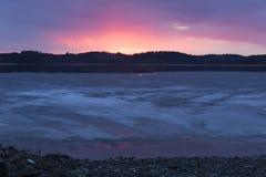 Por do sol sobre o lago na floresta Imagem de Stock Royalty Free
