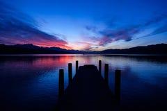 Por do sol sobre o lago Woerthersee Imagens de Stock