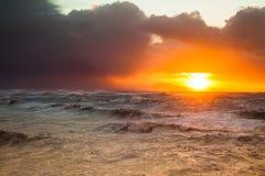Por do sol tormentoso Imagens de Stock