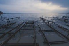 Por do sol tormentoso da pesca Fotos de Stock Royalty Free