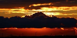 Por do sol vermelho bonito tomado da linha costeira de Davenport Foto de Stock