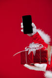 性感的圣诞老人展示poradok惊奇电话 免版税库存图片