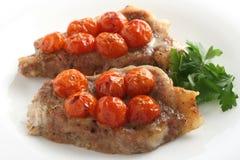 Porc avec la cerise de tomate Photos stock