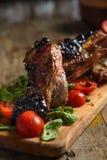 Porc bouilli par froid avec des tomates Photo libre de droits