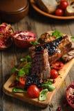 Porc bouilli par froid avec des tomates Photographie stock