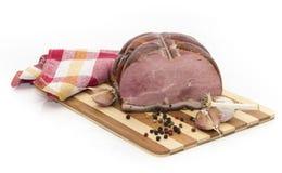 Porc cuit au four par froid avec l'ail et le poivre Photographie stock