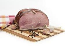Porc cuit au four par froid avec l'ail et le poivre Images stock