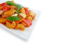 Porc doux et aigre avec la salade de fruits Images libres de droits