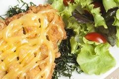 Porc frit avec de la salade Image stock