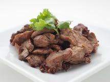 Porc frit avec des feuilles de céleri Image stock
