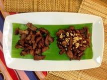 Porc frit dans un plat Photos stock