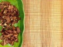 Porc frit dans un plat Photographie stock libre de droits