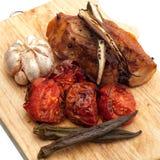 Porc grillé avec l'herbe et les légumes Image libre de droits