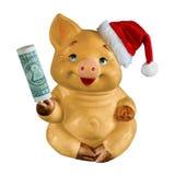 Porc jaune avec le dollar et avec le chapeau de Noël D'isolement sur le fond blanc photos libres de droits