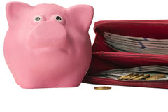 Porc porcin rose avec une bourse pleine de l'argent Images stock