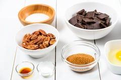 Porcas de noz-pecã, partes escuras do chocolate, Sugar And Egg Yolk fotografia de stock royalty free