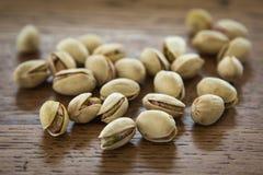 Porcas de pistache em seus shell Fotografia de Stock Royalty Free