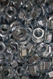 Porcas do metal para o ferro de conex?o e as pe?as de madeira foto de stock royalty free