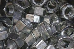 Porcas do metal para o ferro de conex?o e as pe?as de madeira fotos de stock