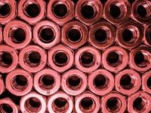 porcas inoxidáveis vermelhas Imagem de Stock Royalty Free