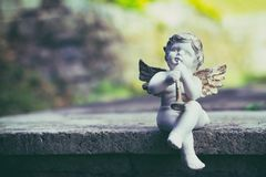 Porcelain angel as decoration in the cemetery Stock Photos