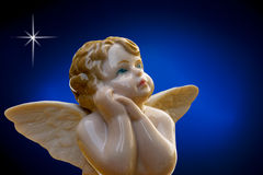 Porcelain angel on deep blue background Stock Image