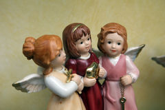 Porcelain angels. Three porcelain angels in a shop-window Royalty Free Stock Photo