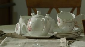 Porcelain antique tea set. Old antique porcelain white tea set on the table stock footage