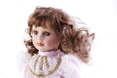 Porcelain baby doll. A close up of a porcelain doll isolated on a white background Royalty Free Stock Image