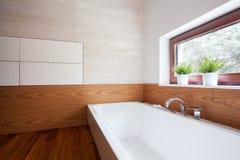 Porcelain bath in modern washroom Royalty Free Stock Photography
