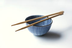 Porcelain bowl and chopsticks Stock Photography