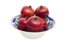 Porcelain bowl with pomegranates Stock Image