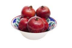 Porcelain bowl with pomegranates Stock Image