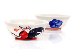 Porcelain bowls with painted chicken Stock Images