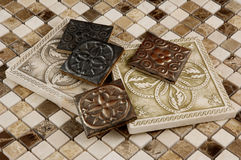 Porcelain, brass and travertine square tiles Royalty Free Stock Image