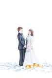 Porcelain bride and groom figurine with pure gold wedding bands Royalty Free Stock Image