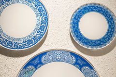 Porcelain chinaware at wall. Porcelain chinaware on the white wall stock photos