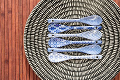 Porcelain chinese dishware with painted spoons Royalty Free Stock Photos