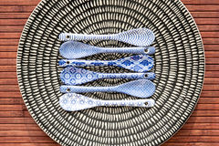 Porcelain chinese dishware with small spoons Royalty Free Stock Image