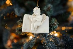 Porcelain Christmas tree decoration toy in the form of cute little angel Royalty Free Stock Images