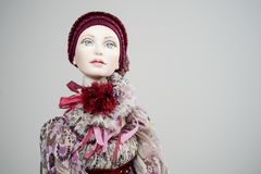 Porcelain clay girl dress red corset victorian. Porcelain paper mache clay statuette girl pretty woman young girl dress beauty handmade handcrafted toy craft Stock Photo