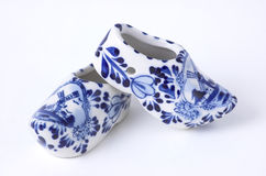 Porcelain clogs. Set of Dutch porcelain clogs, traditional souvenir from Holland Royalty Free Stock Image